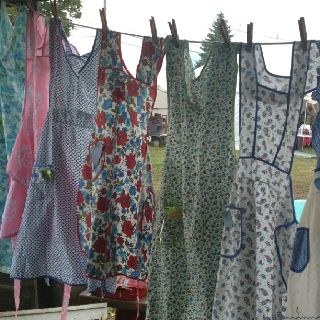 Summery aprons on the laundry line.