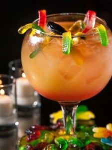 Witch's Brew - Halloween Cocktails: 2 ¼ oz bacardi light, 2 ¼ oz meyers rum, 1 ¼ oz bacardi 151, 2 ½ oz pineapple juice, 2 ½ oz orange juice, 1 ¼ oz sour mix, 1 ¼ oz grenadine. (should be a pinkish-red color). Throw in a handful of gummy worms.