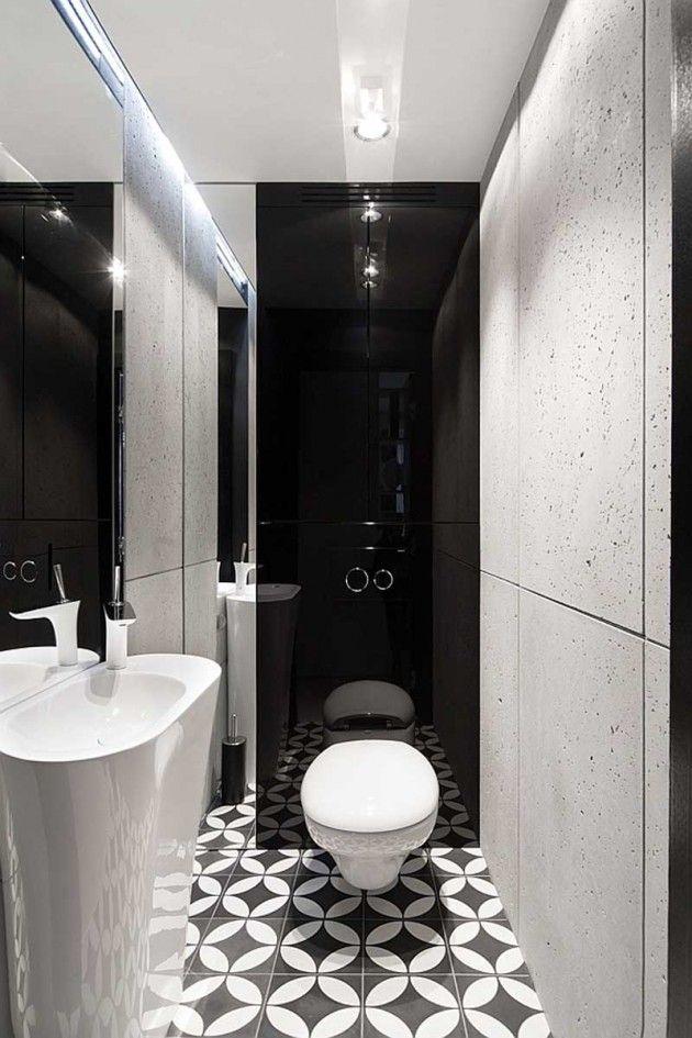 Một phòng tắm nhỏ đơn sắc với sàn hoa văn, bê tông thô, gương hoặc MDF mài đen.