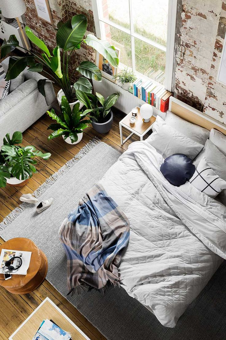 Loft apartment | Indoor plants | greenery | exposed brick wall | cosy bedroom | The Good Sheet