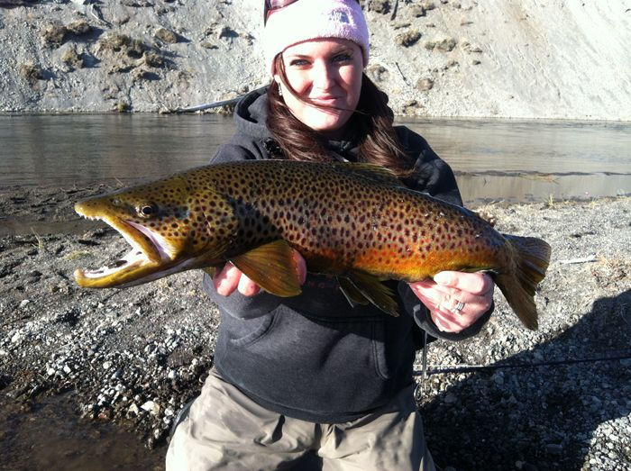 Maggie Mae Kuhlman guides at Lone Mountain Ranch in Big Sky.  She has an impressive brown trout on the fly.