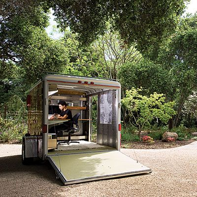 When Stavropoulos heads to a job, he tows this 2003 cherry-red trailer behind his Honda CR-V.  The (solar-powered) mobile studio's loading ramp swings open to views of the real garden as Stavropoulos gets to work.