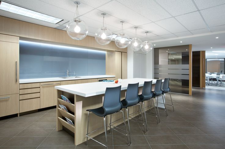 SSDG Interiors Inc.   workplace executive office: Financial Institution. Bright and modern interior design of an office in Vancouver. Office kitchen with wood cabinets, backpainted glass backsplash, white quartz counter, glass pendant lights, and grey tile.
