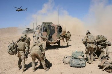 Aussie Soldiers in Afghanistan jumping on Blackhawk's.    Story on news4us.com