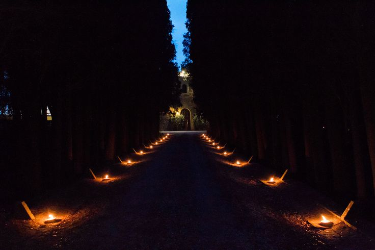 path to the entrance with torch illumination