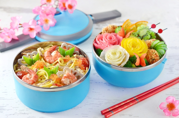 Yunita's bento (Indonesia).  Bento 2013 contest Grand Winner!  Chirashi Spaghetti Bento This bento is inspired by Japanese unique Chirashi Sushi. For the spaghetti, I go with my favorite simple, light, yummy and healthy Tuna Spaghetti with cherry tomato. In another tier, I have rose flower bouquet (made from rolled thin egg omelet), yummy salmon cake (enjoyed with mayo and hot tomato ketchup), blanched broccoli, carrot butterflies freshen up with kiwi fruit, orange and kyuri cucumber slices.