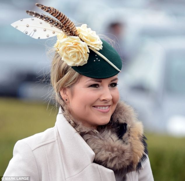 Birds of a feather: A blonde racing fan sported a fur collar and a feathery fascinator on the first day of the Cheltenham Festival 2013
