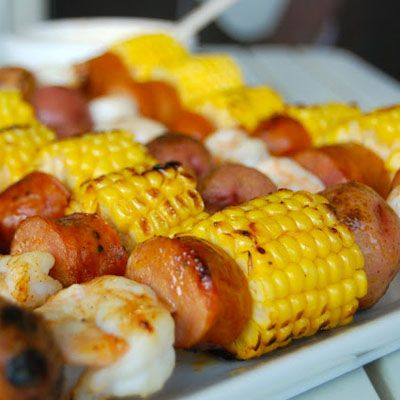 An easy, summer dinner. Shrimp, sausage, corn and potato kebabs! Used Frank's Buffalo Sauce instead of tobasco.