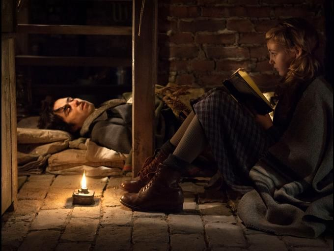 In this picture it shows when the character Max was sick and Liesel would read to him everyday into the night because she thought it would help him get better. Liesel really cares for Max even though he not part of her family and puts her family in danger.