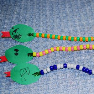 Slinky Bead Snake Craft | AllFreeKidsCrafts.com                                                                                                                                                                                 More