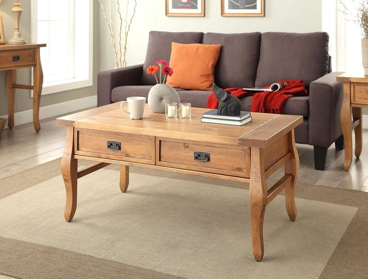 """Linon Santa Fe Coffee Table Antique Finish. The Santa Fe Coffee Table will add the traditional aspect you're looking for to your living room. The Antique finish is timeless and perfectly complements the rustic hardware. Add a bit of storage to your living space with the Santa Fee Coffee Table with its convenient twin drawers. Use the table top to display design pieces, pictures or magazines. The slightly curved legs add a modest touch of style to the table.Product Dimension: 44.02"""" W x..."""