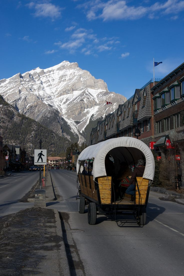 Wagon ride through downtown Banff with a great view of the Canadian Rockies.