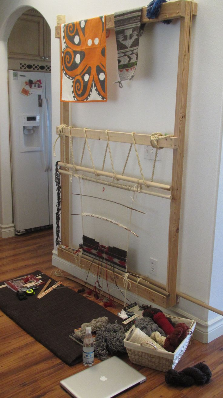 My weaving setup.  Navajo style loom mounted to wall that can handle up to a 3'x5' rug.  Currently working on my second piece, It is only about 2'x2'.