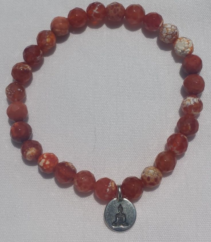 Fire Agage mala with Buddha charm. $45. IM me if interested