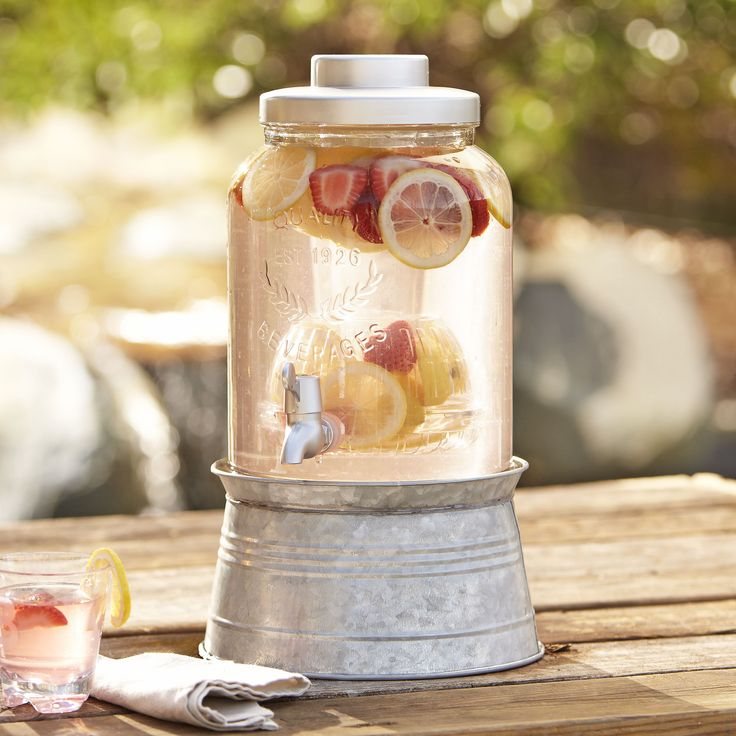 Birch Lane Galvanized Beverage Dispenser - Pour lemonade, iced tea, chilled water, and infused beverages to order from this lidded glass vessel on a galvanized steel base. Holds two gallons.