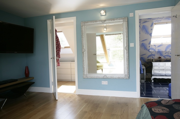 A large mirror adds lots of light to any room