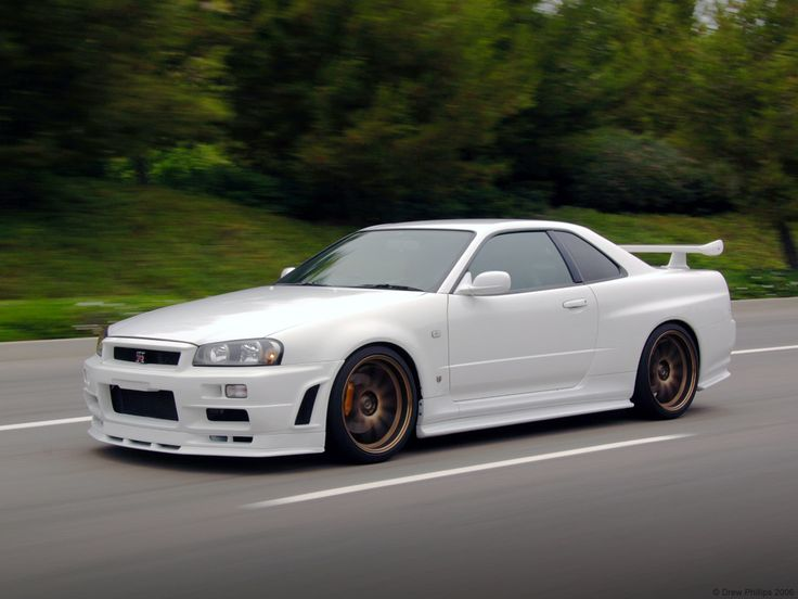 The Nissan Skyline R34 Spec-V. It is one of the ICONIC Japanese sports cars of the late 1990s (Toyota Supra MKIV too.) Made famous by the Fast and the Furious movies. Neck-breaking acceleration thanks to all-wheel-drive, handling and memorable styling make this a modern classic. They never officially brought the Skyline to the states because it didn't meet emissions regulations and you can't import one into the country anymore.