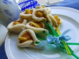 Lily sandwiches for the feast of St. Joseph: Peanut Butter, Bread, + Banana with yellow sugar sprinkles.