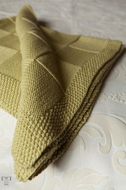 Ravelry: Blocks for Baby pattern by Danielle Romanetti - seems simple though. Basket stitch blocks with a seed stitch border and then lined with flannel.