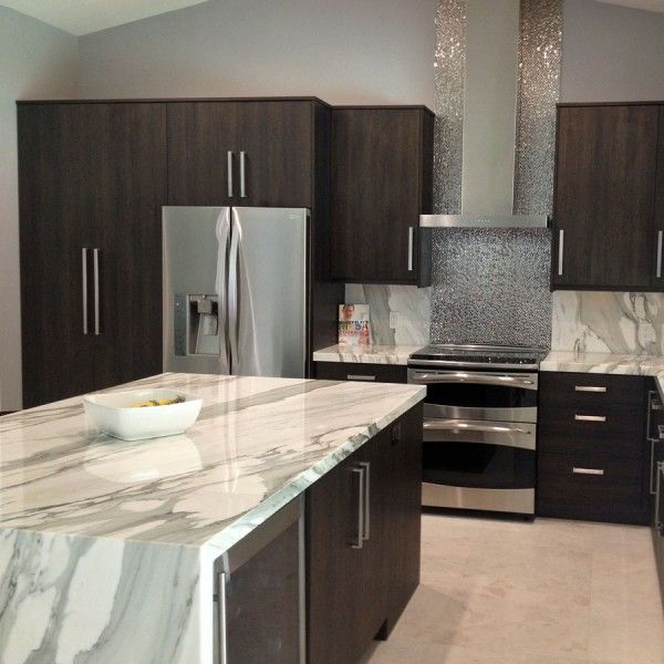 Kitchen features dramatic calacattaborghini marble for Perfect kitchen fabrication