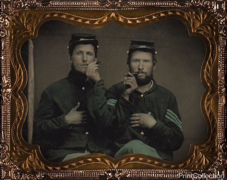 Civil War Brothers in Arms Two | PrintCollection Two unidentified soldiers in Union uniforms holding cigars in each others' mouths. Created between 1861 and 1865 as a ninth-plate tintype, hand-colored ; 6.5 x 7.5 cm (case) Photograph shows uniform of soldier on right with blue chevrons of an Infantry Sergeant.