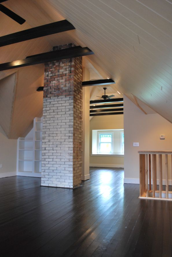 I love these finished attic ceilings and contrasting-color beams, and the openness of the spaces. Several photos from a 2009 attic remodel. Would love to talk to the designer!