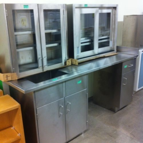 Tips For Buying Garage Utility Cabinets: The Stainless Steel 5 Piece Cabinet Set Includes A Utility Sink, A Sliding Door Cabinet Upper
