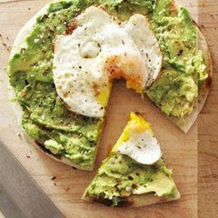Make what is in the picture for breakfast. Pita, avocado, over easy egg