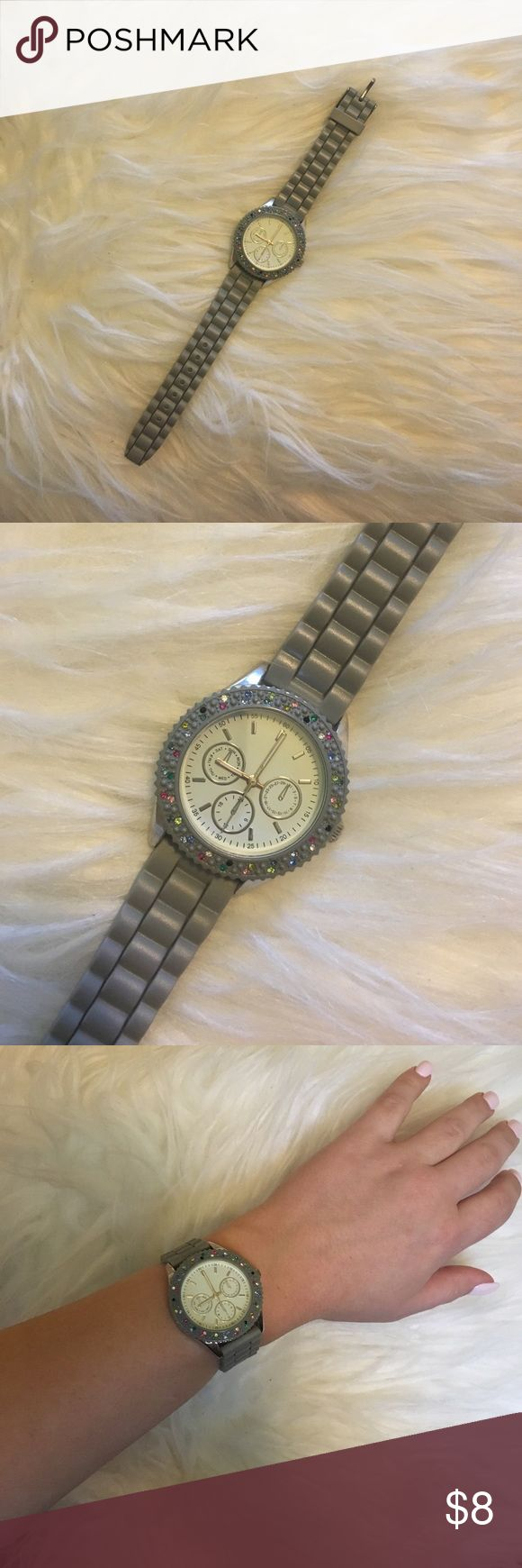 Women's grey and multi color watch Grey band with multi colored rhinestones around face of watch... no missing rhinestones.. needs a new battery, otherwise perfect condition! Accessories Watches