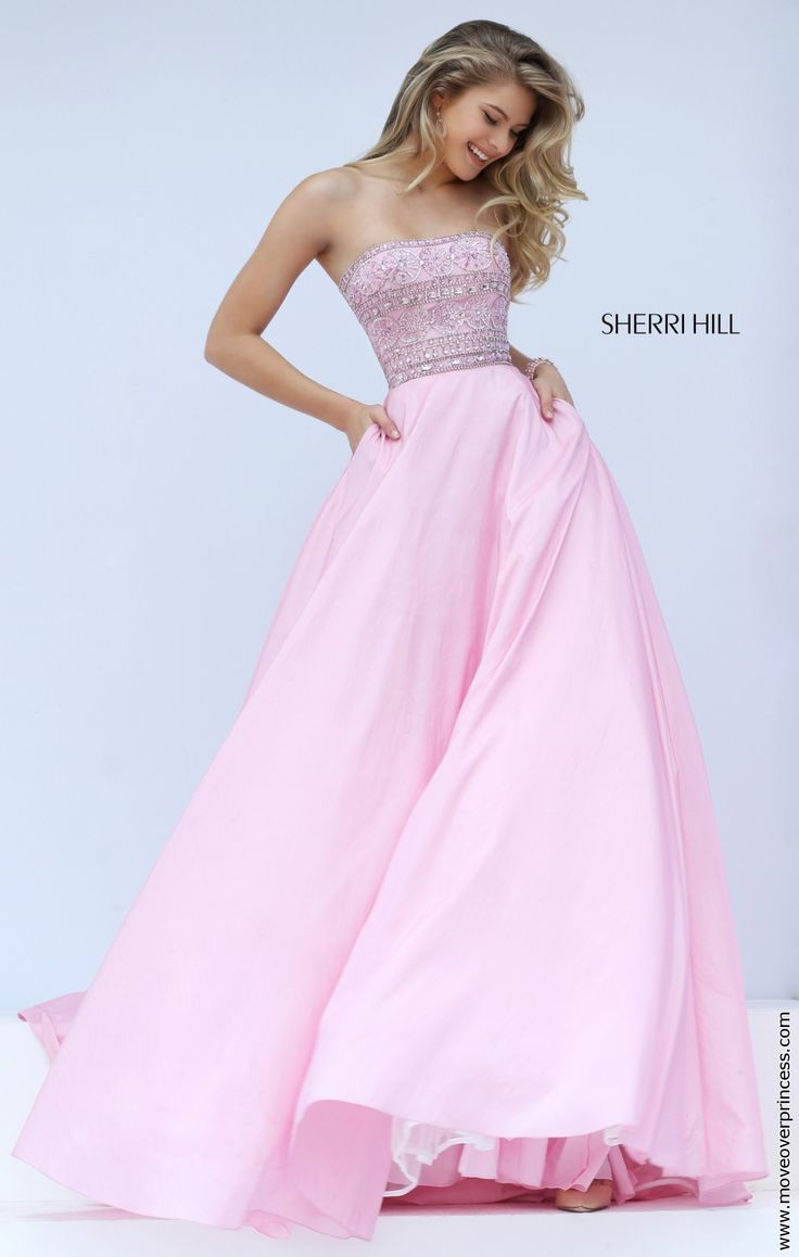 Strapless gown by Sherri Hill with a exquisitely beaded bodice and a long full skirt. The bodice has a straight back which is great for girls who want to wear a strapless bra. View Size Chart
