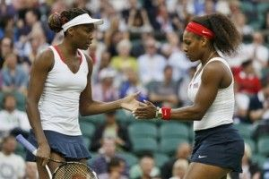 Serena and Venus Williams advanced to a dramatic US Open quarter-final showdown with straight-set triumphs while Canada's Eugenie Bouchard withdrew from her fourth-round match due to a concussion.