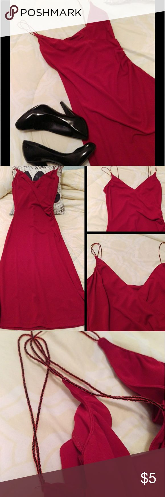 Red H & M Dress Red H & M dress size 4 Thin red beaded straps  Ruching on the left side (slight damage, see pic).  Gently used, not sure what caused it but there are multiple thread pulls on the front bottom of the dress (see pics) and a small stain (pictured under the penny). Price reflects damage, sold as is. Please feel free to ask any questions. H&M Dresses Midi