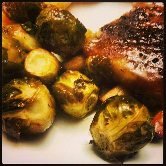 Asian Invasion ribs with (sauce from movable feast  delivered to your door from GBD) fresh roasted Brussel sprouts with sea salt + olive oil