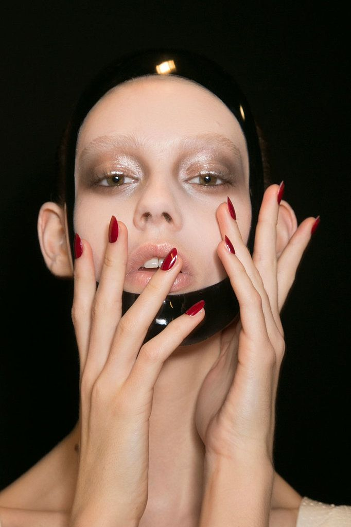 The Spring 2015 show had plenty of leather, and the vampy red nail varnish only added to the dominatrix beauty look. #PFW