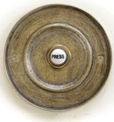 Door Bell Cover in Antiqued Brass