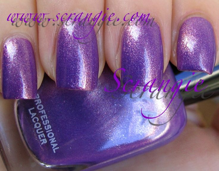 This picture can't begin to cover how beautiful this polish is.  Zoya Dannii.  It's purple with copper sparkle.  Shiny pretty.  And purple. ~$8.