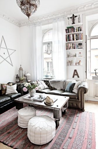 I like that contrast of the dark on the white broken up by the washed out red and grey rug. I want to throw my Mexican blanket over the back of my leather sofa now...