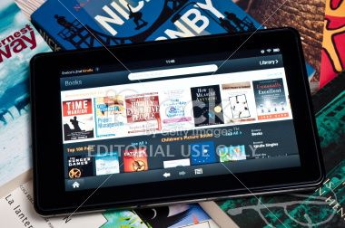 Amazon Kindle Fire tablet on a heap of books Royalty Free Stock Photo