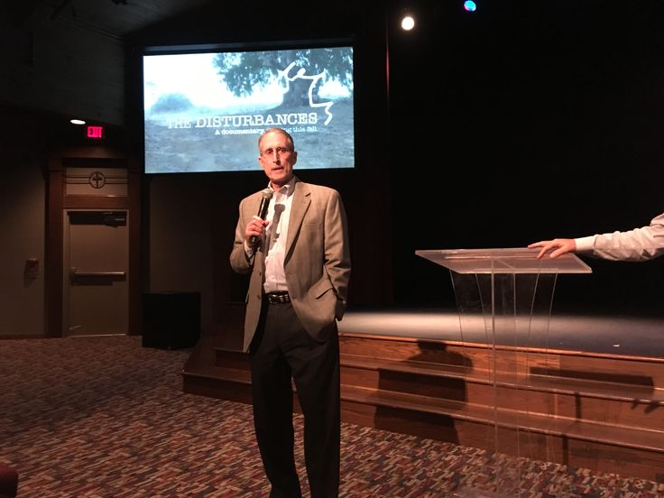 """Robert Parham, co-producer of """"The Disturbances,"""" speaks following a screening of the film at Christ Church Nashville on Sept. 8. Photo by Cliff Vaughn."""