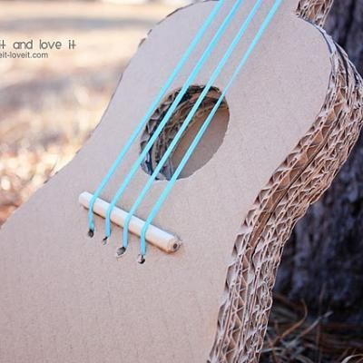 kid's toy guitar made from reclaimed cardboard, pencil pieces, and rubber bands--tutorial AND pattern!