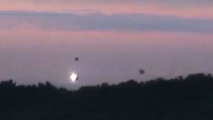 "A video posted on YouTube has caused a fair amount of intrigue as it appears to show four UFOs hovering in the sky above a forest in the Dordogne, southern France. Scientists have so far been unable to explain the objects...  According to description of the video, which is written in English, the images were shot at dusk on July 4 near a small ""ghostly"" village, home to around 50 inhabitants, whose name is not specified."