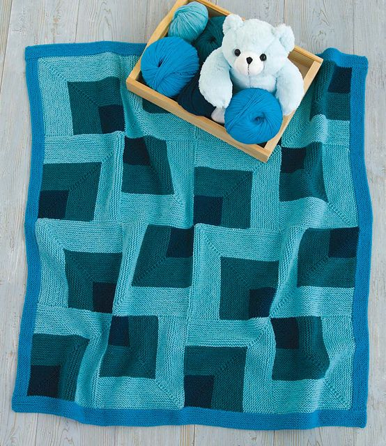 An asymmetrical pattern of mitered squares is the height of cool in rich shades of blue.