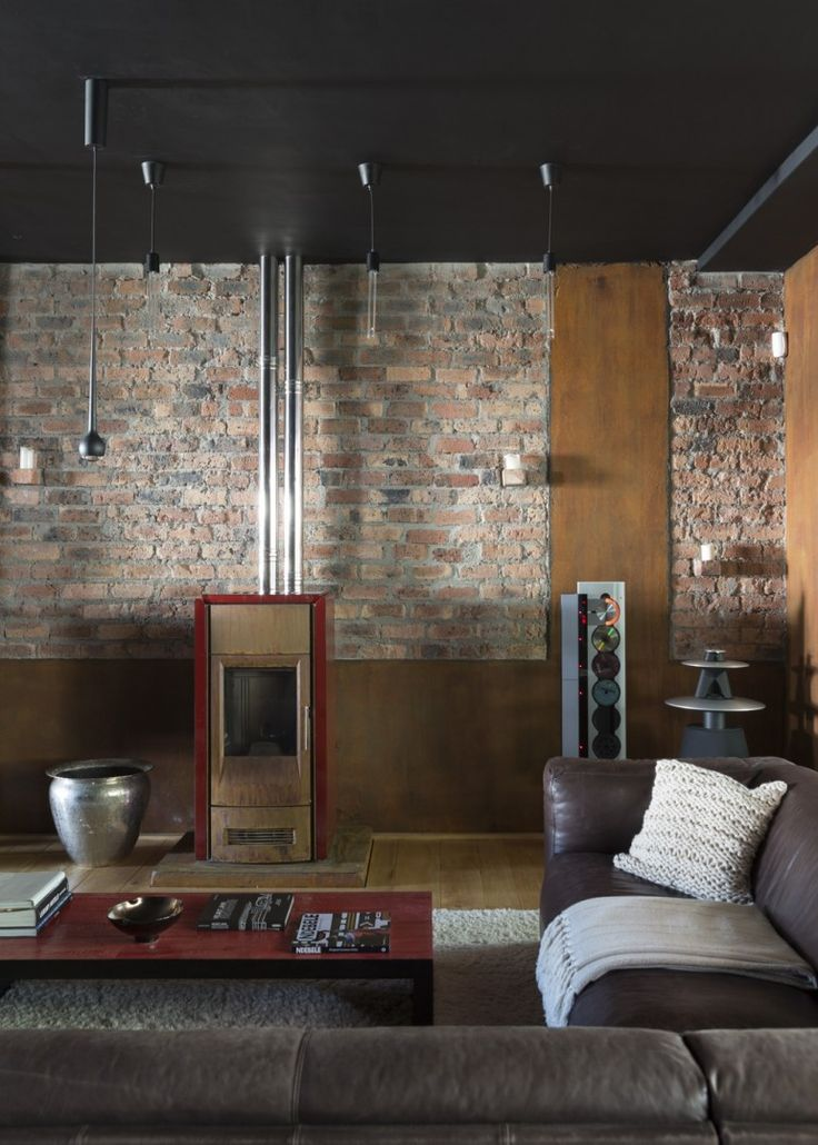 Alphen Awakened - cosy couch and fireplace - with warm, dramatic finishes and colours