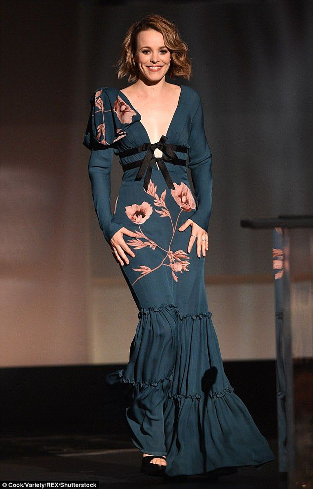 Simply stunning: The Mean Girls star, 38, wowed in a plunging teal gown, which featured a ...