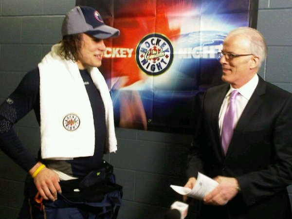 Ryan Jones prepares for his Hockey Night in Canada post-game interview with Scott Oake in Denver - March 5, 2011