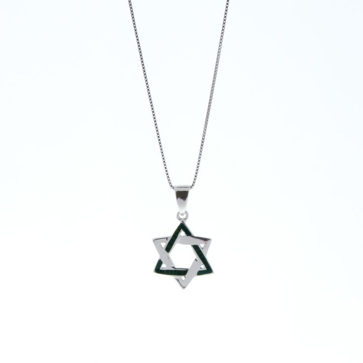 Handcrafted 925 Sterling Silver Star of David pendant necklace. A delightful creation featuring a fine silver chain adorned with a silver Star of David, set with fine asymmetric manmade Turquoise. This inspiring pendant necklace is the perfect accessory to connect you with tradition in style, all day every day.