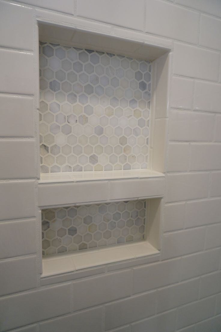 HomeARCH Renovations. Tiled Shower Niche. Carrara hexagon tile.