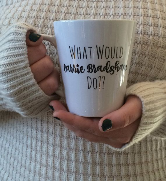 This adorable mug is created locally and can be customized. If you are interested in customization, send me a message! My What Would Carrie