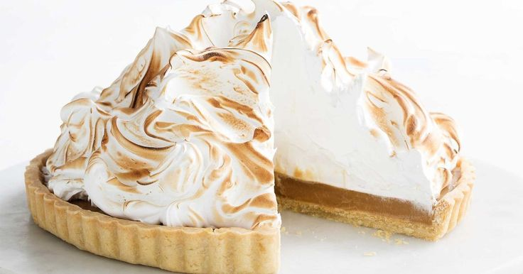 Beautiful butterscotch pie with billows of fluffy meringue and a buttery pastry crust.