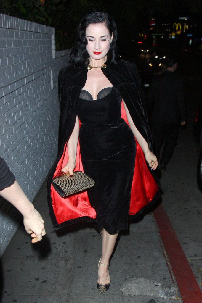 Dita Von Teese... You know you have reached an elite level of overall fabulous when you look fucking incredible walking out in your exposed brazier and Dracula cape.